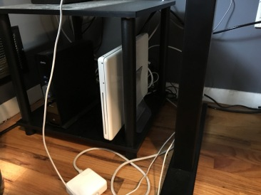 My server used to live next to my desk along with our router and backup drive.